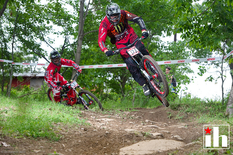 Brendan jumps out of the first corner during US Open DH Practice with Troy Brosnan following him.