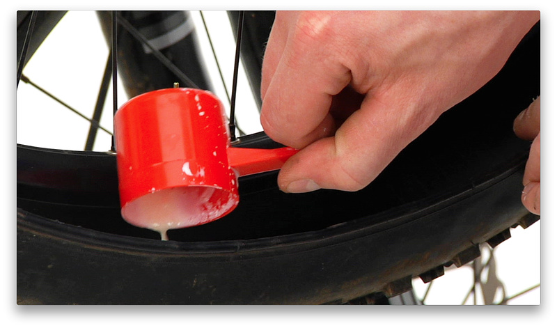 2:42 mark - Add the appropriate amount of sealant for your tire size
