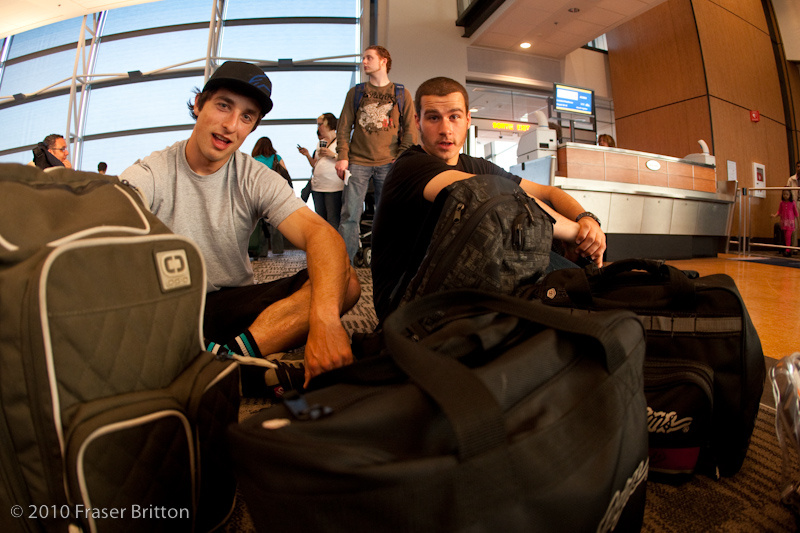 Steve Smith and Luke Strobel living the less glamorous side of World Cup racing - a broken plane, missed flights, sitting on the floor next to bike bags floor and lots of airport lounge booze.