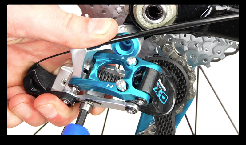 Step 1. Shift your rear derailleur to the smallest cog/hardest gear. Trim the old cable end off and use a 5 mm allen key to loosen the cable anchor bolt. Take note of where the cable is clamped (above or below the bolt) as this can greatly effect the shifting