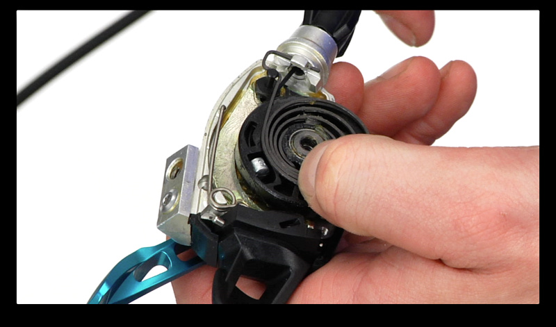 Step 5. You may have to gently pull aside the large spring to allow the cable end to exit the shifter. It only needs a few mm's of extra clearance. You might have to do the same thing when installing the new cable