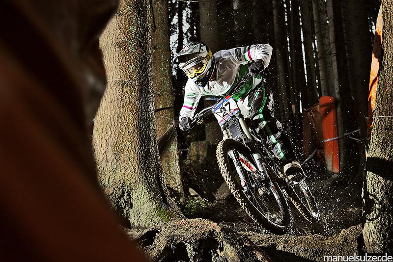 Ben Reid flying through the mud in Leogang, Austria - World Cup Round 3 - www.manuelsulzer.de