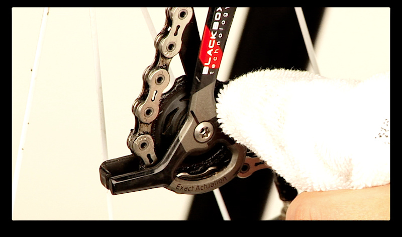 Step 5. Use a clean rag to wipe off any and all chain lube that may be on the outside of the chain, including the side plates and the derailleur's pulley wheels. Extra lube will only attract dirt and create a mess. The only lube that you want on your chain is in the rollers and between the chain plates