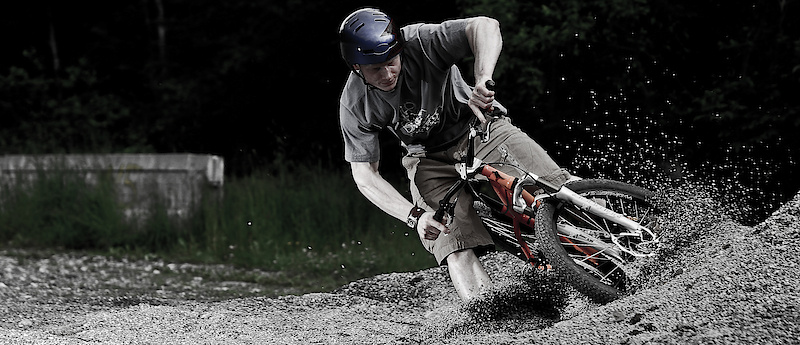 using a pile of gravel as a burm quite a few crashes but even though this one looks so sketchy he actually made it out of this to mine and his amazement