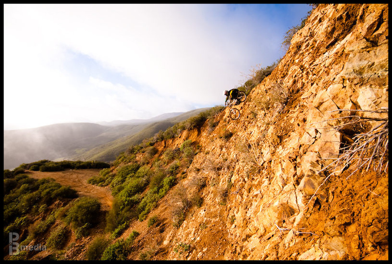 We shot this for Golden State, a slideshow on mountain biking in California. You can see the whole sequence in the slideshow in my profile.  I was setting up another shot down the trail, when he started climbing up this cliff. He wanted to do it, so we shot it and ended up with this.