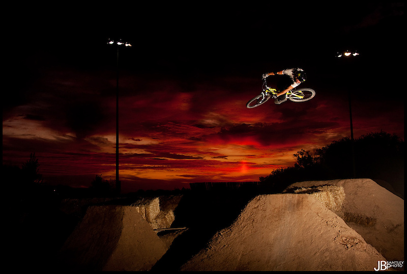Doing a his classic dumped 3 with a sick sunset!