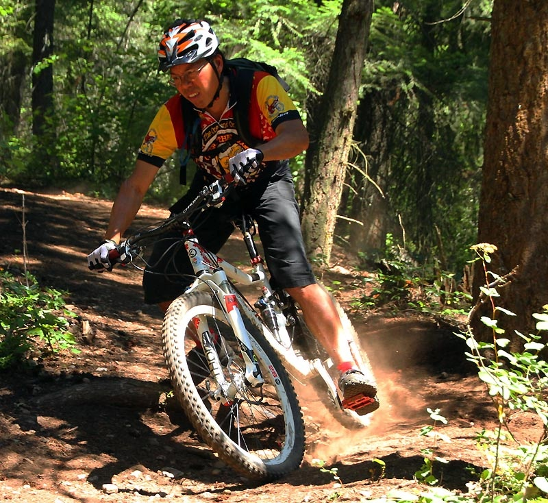 Cornering hard on an off-camber turn in the Rubberhead trails - Salmon Arm, BC.