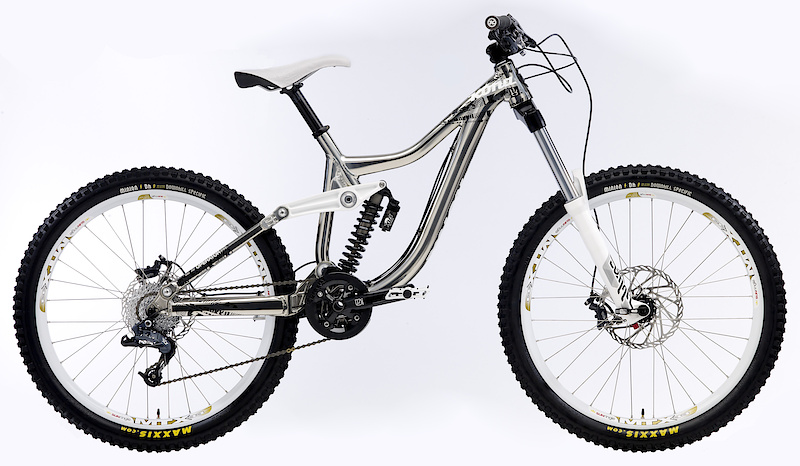 Not Paul's personal bike, but this is a Kona Operator set up with single crown forks.  He was going to use a similar set up at this year's Rampage.