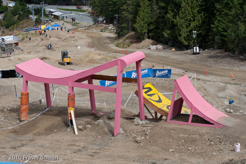 The whale tail step-up step-down was at the end of the course last year, but gets moved to a mid track position for 2010. Hidden beside the pink beast is the Mavic booter that may attract the big mountain riders, braaap!
