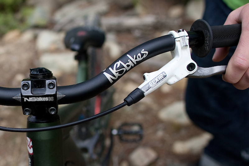 An assortment of NS Bikes parts are hung from Sam's Diamondback, including the stem, bar and sweet looking pedals. He holds onto comfy Sensus grips.
