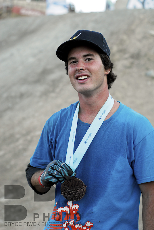 Casey Showing off his medal. Way to go Casey! Life is about to change