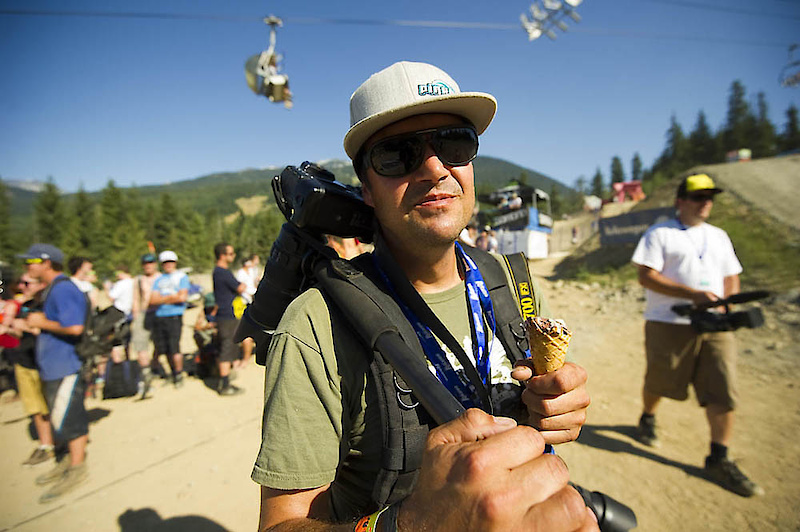 Pinkbike's lead lensman, Ian Hylands: well prepared for the Crankworx Slopestyle Comp (note the ice cream cone).