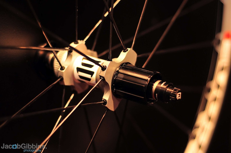 The interesting feature of these wheels is the use of both radial and 1-cross straight pull spokes on both sides, alternating between cross and radial to create the 24 spoke design.  The advantage of this is touted as allowing the radial spokes to produce a laterally stiff wheel whilst the less laterally stiff cross spokes take care of coping with and transmitting both braking and pedalling forces.  As with the more expensive wheelset, the EUR765 M1700 wheelset offers stainless steel bearings and star drive ratchet as well as a splined Shimano compatible disc mount.