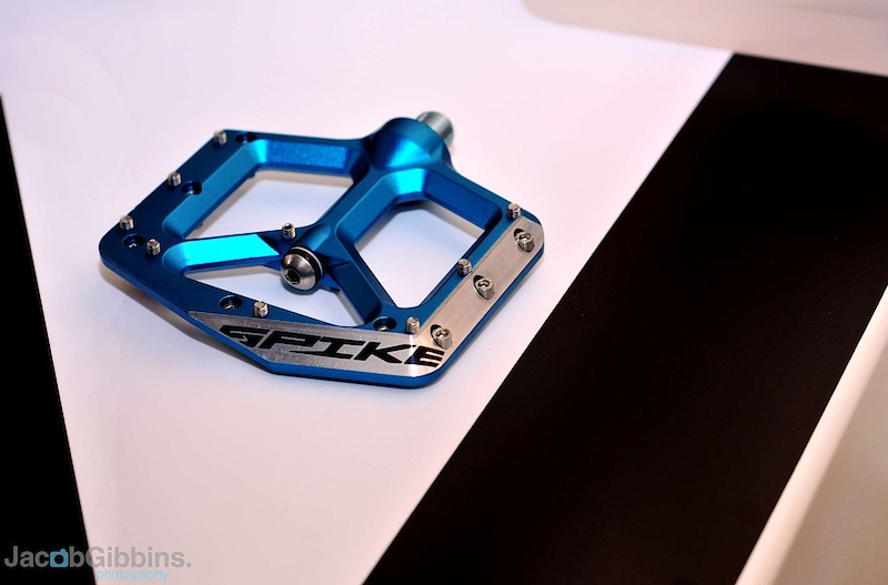 Is 2011 going to be the year of the pedal? We've seen a number of new options for the coming season, but the new Spank Spike pedal stands out from the crowd with their rather striking body profile and chamfered leading edges that are designed to glance off of whatever trail obstacle that you catch them on, as opposed to simply stopping you dead. I think we've all hit the deck hard from pedal strikes, you're on the ground before you knew what hit you, so I'm all for anything that lessens the chance of that happening. Further helping the cause is the slim body height, measured out at a thin 12 mm. The Spike's spin on a combination of oversized, sealed bearings and IGUS bushings that allow the pedal body to have a thinner footbed, but it flares out to house the bearing close to the crankarm. There are 18 pins per side, with all but the single central pin threading in from the opposite side to make removal of damaged pins easier, and they weigh in at a competitive 400 grams. MSRP starts at $119 USD.