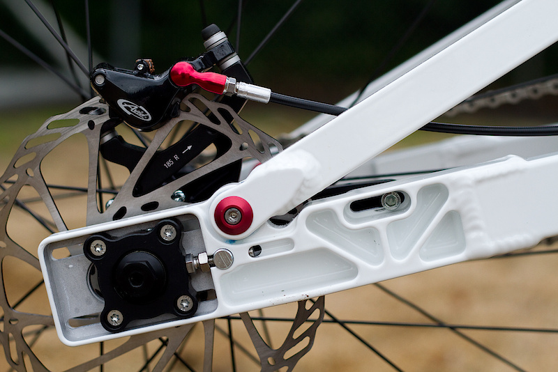 An adjustable wheelbase lets you fine tune the handling and tension the chain. The rear cog, drive chain, and disc rotor all stay in place when you remove the hub from the swing arm - pretty cool!