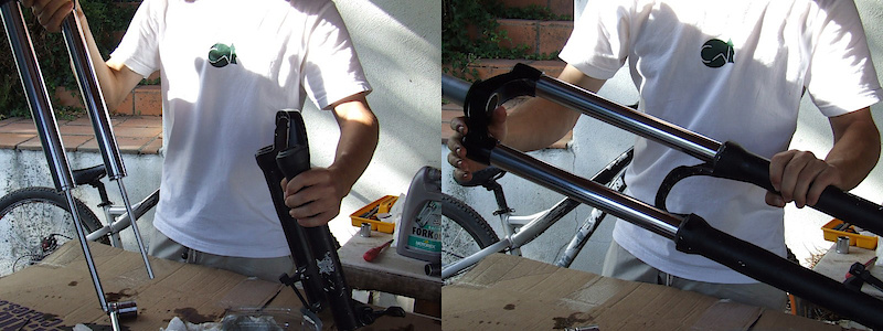 <span style='font-size:20px'>Step 21.</span> Align the stanchions with the fork lowers and very carefully slide them past the outer dust seals. It can help to start on an angle to prevent tearing the rubber dust seal. This may take a few tries.