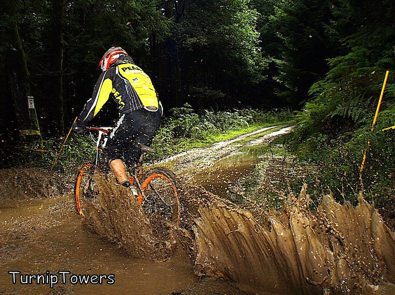 This mud puddle appeared quite suddenly during the practice session at Bucknell, as rainwater poured down the uplift road. This meant that by the time riders realized that it was there, they were already in it so I managed to get quite a few shots although I got soaked in the process!  This is Zac Emmett soaking me.