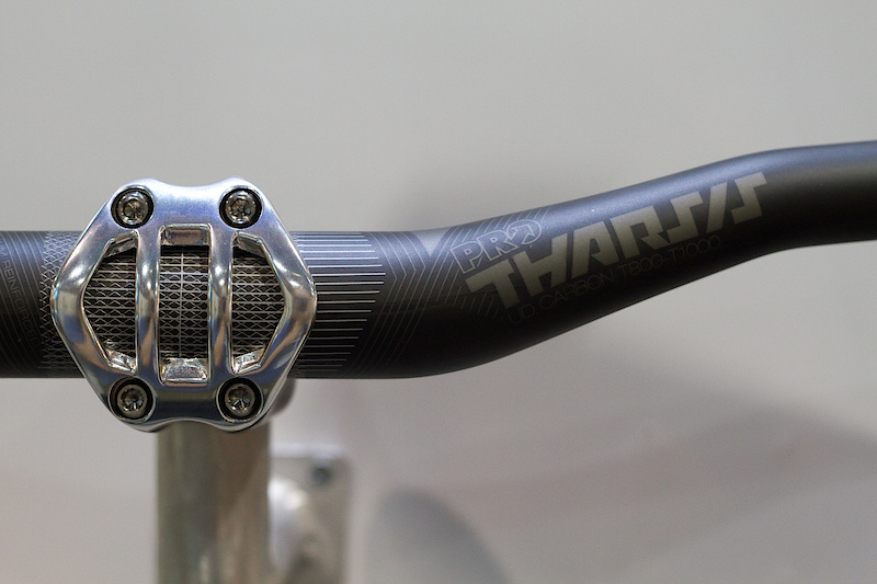 There is a Tharsis bar as well, done in carbon, naturally. It uses the same matte finish as the stem and post and is made using unidirectional carbon with a titanium reinforced center section. If you don't have enough titanium or carbon on your bike yet, these bits would be an easy way to remedy that! The 710 mm wide bar has 20 mm of rise, 8 backsweep, and 4 upsweep. Total weight of 195 grams.