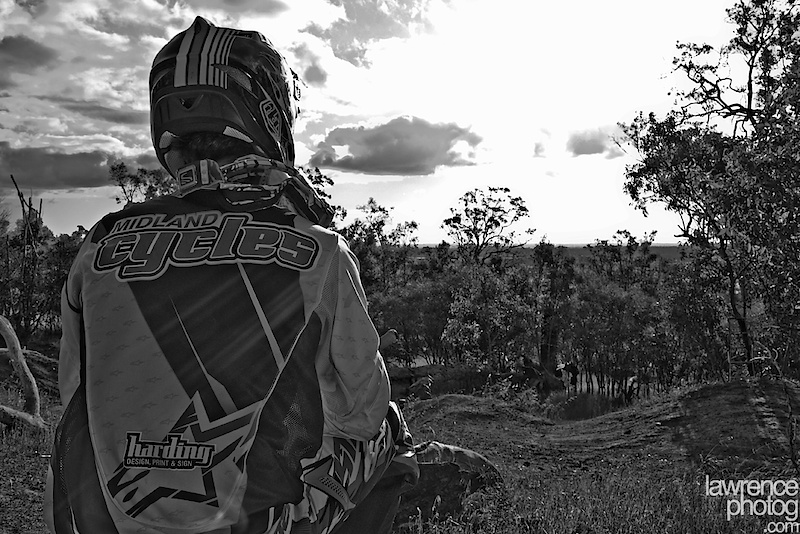 Cliche rider looking off into the scenery shot...