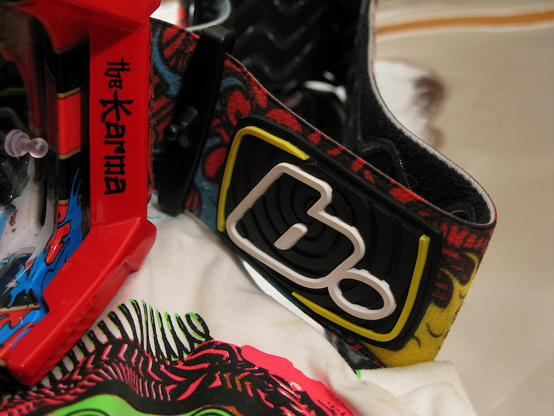 As fit is personal, so is coloring and there should be something available to suit all tastes; from the slightly subdued black Phobia to the far more wild and lurid red Karma (both featured here).  Graphics extend from the painted frames onto the straps with matching rubber logo on the left hand side, all wrapped up in a similarly decorated microfiber bag.