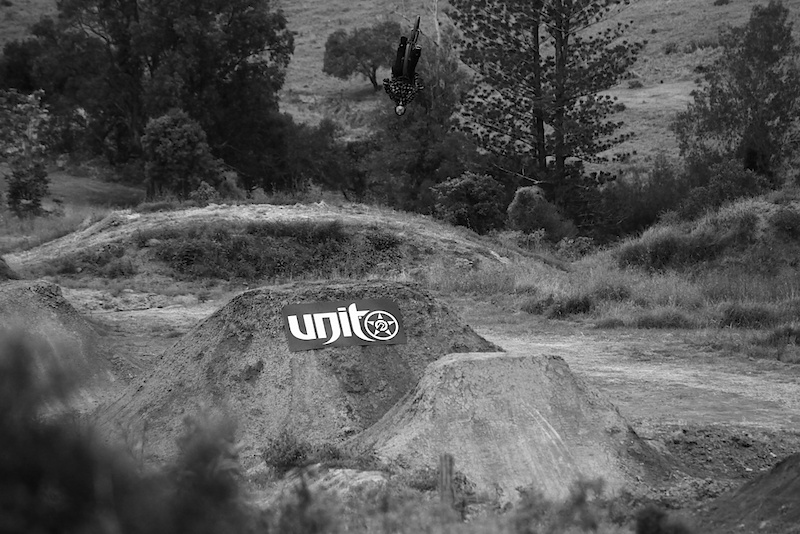 Backflip for the camera over the 35 footer.  Photo: Rain Turnbull for Unit www.unitriders.com