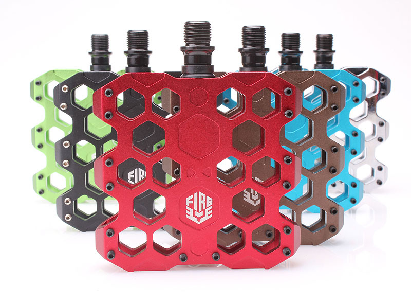 Hive Pedal, honeycomb shaped pedal, its distinctive honeycomb design also relieves excess weight while still retaining the pedals strength. Available in 6 colors!