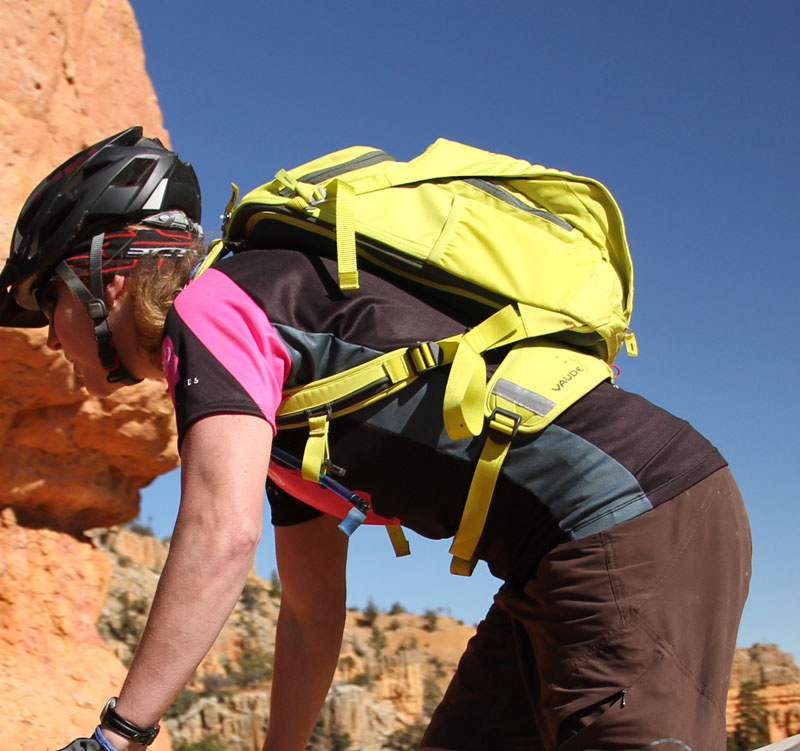 <span style='font-size:17px'>Riding in the Utah desert</span><br><br>Fully loaded with water and the gear that I like to carry brought the pack up to 10lbs, but keep in mind that this will vary greatly depending on what you stuff it with. Fitting the Tracer 12 was quick, the straps were easy to adjust to ensure that the pack sat quietly on my back. Although the photo's show the pack quite high on my back, it really didn't feel that way when riding. This could be due to the thick sturdy hip belt and Ergo vent pads helping to distribute the weight of the pack. On top of being quite comfortable overall, the Tracer's ventilation did its job wonderfully. My back never seemed to get overly hot during rides. I'll admit that the dayglo lemon and pine color won't be for everyone, but it provides great visibility when in the bush - how many of you ride during the hunting season? On more technical trails where I was moving around more aggressively the chest strap was essential to keep the pack still and in place on my back, but when adjusted correctly the Tracer stayed put admirably.
