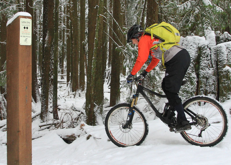 <span style='font-size:17px'>The Tracer 12 carries enough spare clothes for snowy rides</span><br><br>Accessing the pack during rides was easy, so long as I remembered which compartment I put whatever it was that I needed. I never felt lacking for space, even in cold weather riding when I would take extra gloves, jersey and extra jackets in case it got colder or rained. Getting to the water compartment required you to unhook the helmet carry to completely unzip, but you can access the inner compartment with the helmet carry hooks hooked. The Cordura-type material picks up dirt quite easily or is more noticeable on the bright colored pack. I spent some time in the rain while wearing the Tracer to see if it would absorb water, but it shed H2o quite well and didn't get any wetter than other packs would have in similar conditions. In other words, you shouldn't find yourself waterlogged when putting in the miles on B.C.'s