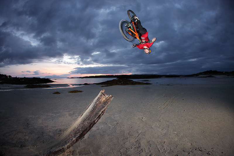 Danny flipping of a driftwood log on Arisaig beach during filming for 'Way Back Home'