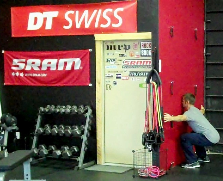 The bottom position of a wall squat, part of the 15 Minute Trail Rider Tune Up Workout.