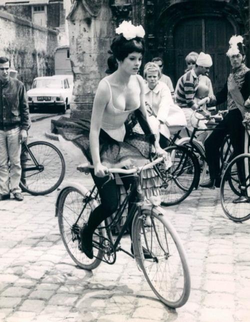 Geneviève Bujold rides a bike