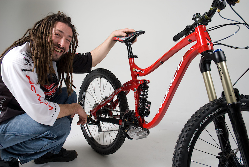 Hoots and his 2012 Norco Truax<br><br>Pictured above is the new Norco Truax 1, a 7 inch travel freeride oriented machine that looks as fun as a barrel of monkeys. The gist straight from Norco: <I>The TRUAX is designed for those riders that are just as likely to pedal up to the trailhead as they are to take a shuttle or chairlift to the top of the mountain before they dive in and revel in their descent. Seven inches of travel and a slack headtube angle make this bike right at home on the way down. Ride it everywhere, every day: jumps, ladders, berms, steep descents, park, shore... wherever you need a fast, versatile and incredibly fun bicycle.</I>