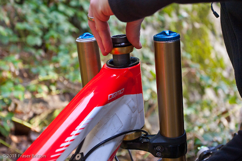 Slide the fork's steerer tube into the head tube, then slide the upper headset assembly onto the steerer tube. Do not press things together yet.