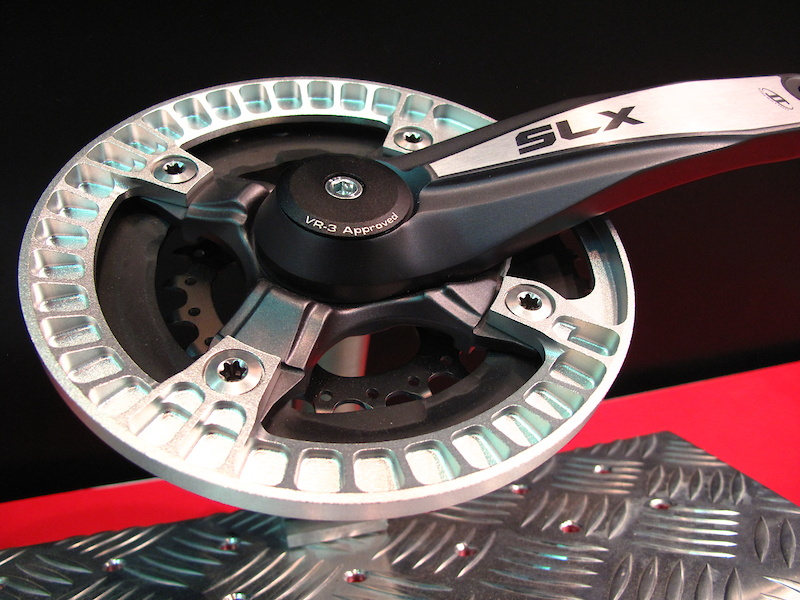 German company Syntace was showing off their new bash guard, the Grinder 36. It certainly looks to be one of the more intricate chain ring guards around, with CNC'd ribs and reliefs around it's entire circumference. Total weight is just 72 grams.