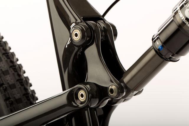 Carbon fiber upper link, angular contact bearings, oversize aluminum axles