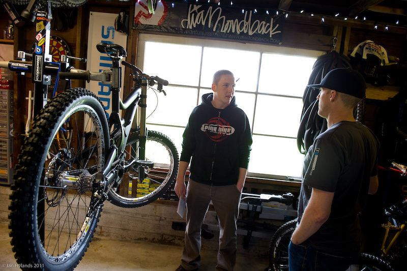 Jon Kennedy (<i>right</i>) explains the ins and outs of what they are aiming for with the new bike. Depending on how testing of future prototypes goes, it could look quite different than what you see here by the time it reaches production. While they could have gone the easy route and adapted their proven Knucklebox suspension to a longer travel DH platform, it proved to be better suited to their All-Mountain and Cross-Country bikes - despite the fact that it would have been easier and faster than designing a new linkage layout. Diamondback is committed to making the new bike a winner right out of the box.