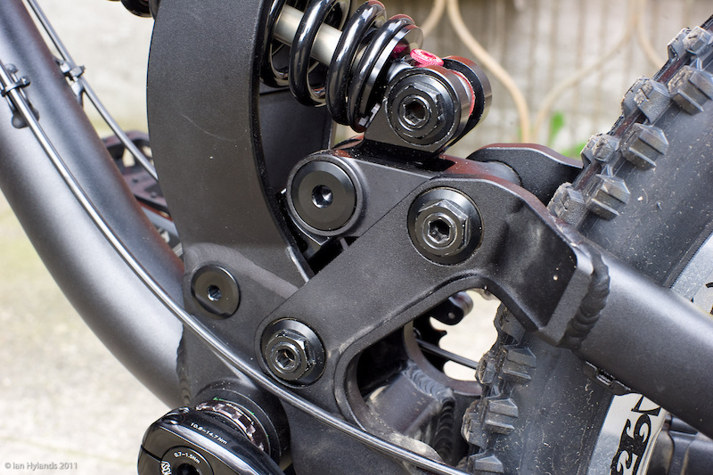 The single pivot swingarm uses a linkage to active the shock. The bike's designers have made an effort to have the suspension parts as low as possible in the frame. Aluminum pivot hardware is used throughout and it is worth noting that you can access all of the bolts without having to remove the cranks or chain guide. It is important to remember that it is the small details that can make all the difference in how a bike rides. Yes, the general layout is similar to some other sleds out there, but by changing the pivot locations by only a few millimeters, Diamondback's engineers can dial in the exact leverage ratios that they are looking for.