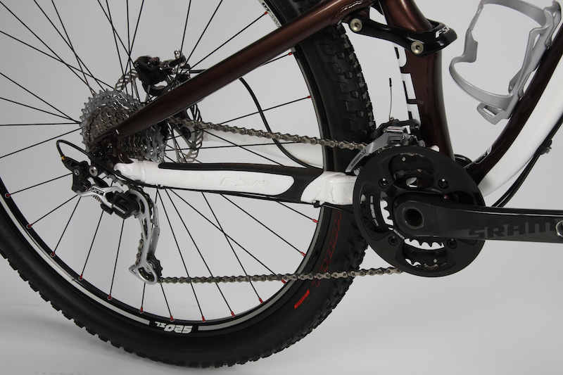 SRAM and Specialized co-developed lightweight guide rings that keep the chain from overshooting the big sprocket on Specialized's two-by-ten trailbikes