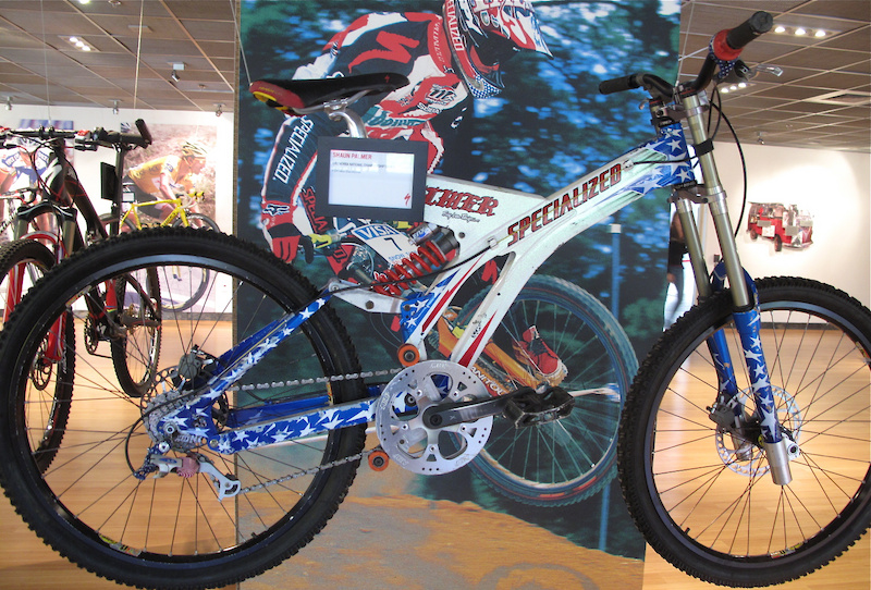 Still looking ready to shred, Palmer's '97 NORBA bike is displayed proudly in the museum for everyone to see when they enter. Bikes have come a long way, but this bad boy gave me goosebumps. Manitou's X-Vert carbon (<i>with extended travel and integrated stem</i>), those old and much sought after Michelin tires and a very patriotic GripShift shifter and derailleur combo. Judging by the size of that ring, Palmer was looking to hit mach chicken during his race runs!