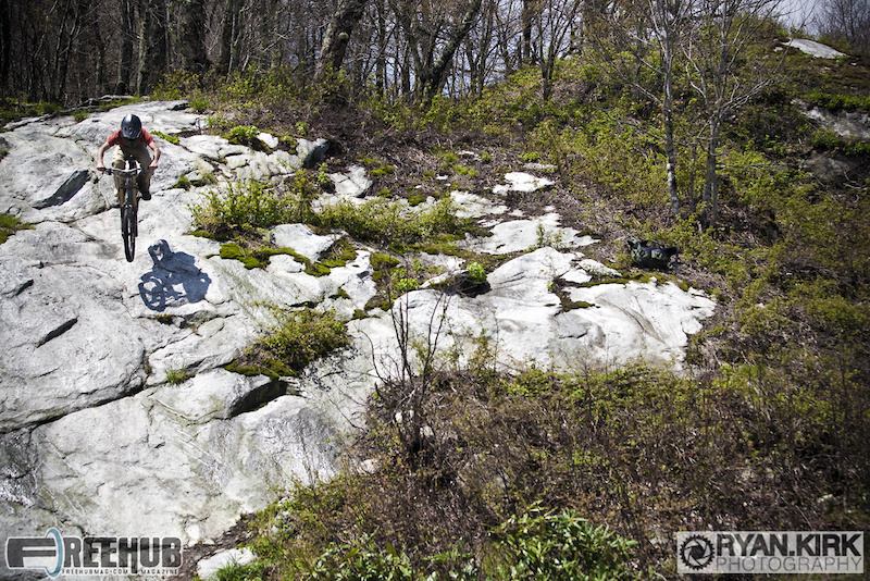 Local Boone rider Steven Trottier gap'n into the rock gnar on Sugar Mountain.