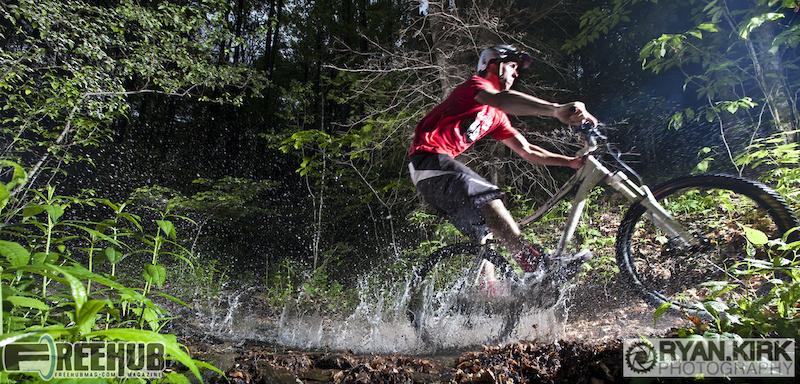 Rider Jon Angermeier for a splash down on Daniel Ridge in Brevard, NC.