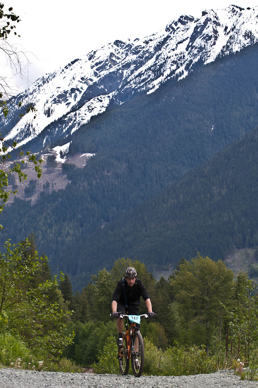 Chromag's Ian Ritz rolling along on a prototype 29er under the gaze of Mount Currie