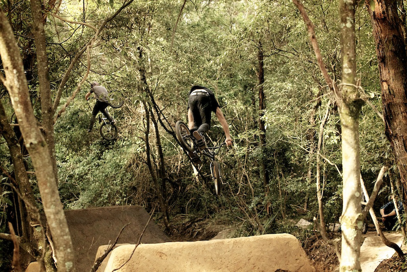 Josh Stead and Chris Harti flowing the trails for Unit s next BMX trails video. Photo Raine Turnbull