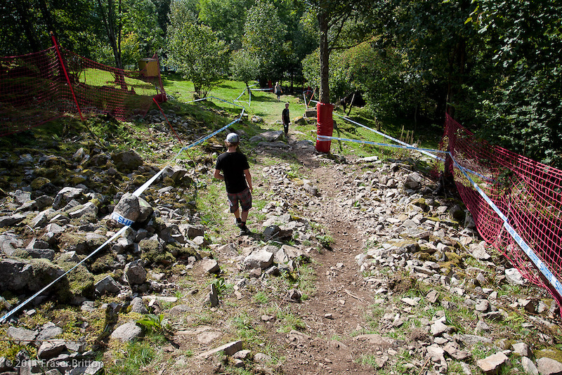 The tight left leads into a mini alley and then into a rocky chute into the trees.