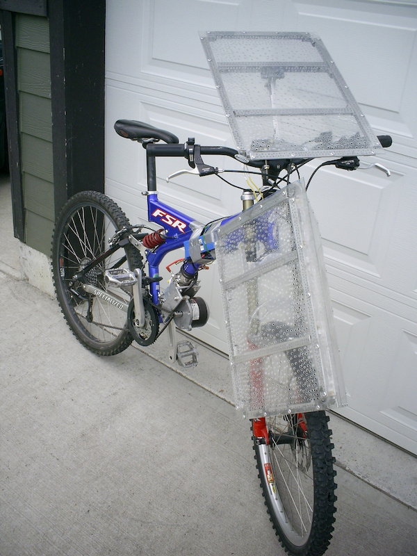 Solarcross 1998 Specialized FSR Ground Control W Pedal assist 5T motor sprocket drives an 80T sprocket mounted to a large amp small chain ring mounted on an BMX 16T Freewheel 1 Horse power 24 volt motor 50 kph capable in 1 city block distance 750 watt 24V controller hand made polycarbonate aluminium fairing panels to attach 18 PV cells 0.5V 8A in series