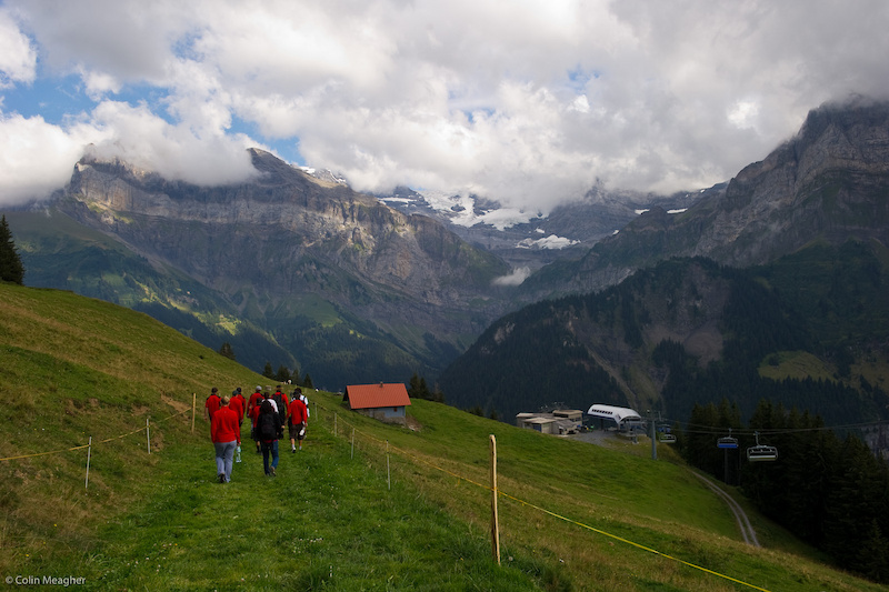 The Swiss team walking down from the lift to do their course walk.