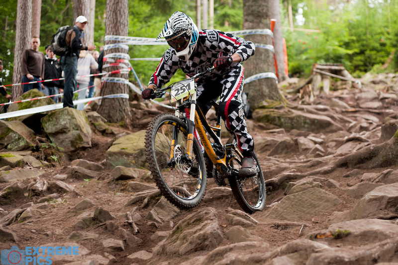 iXS German National Championships race action showing the huge root sections to be found in the Black Forest.