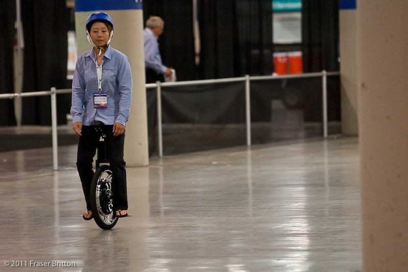 This girl must be hating her life. She spent all day down on the secondary show floor in the basement doing hot laps on an electric unicycle. Doesn t she looked thrilled Must be the next big thing.