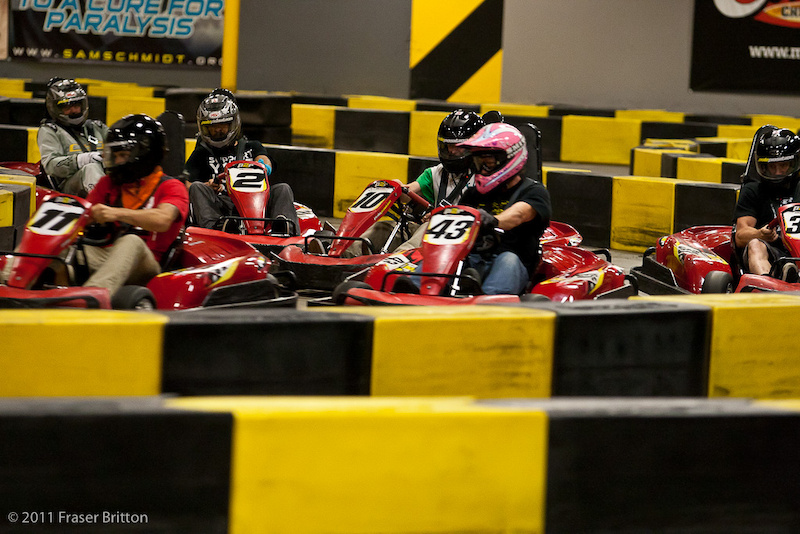 And now it s a complete disaster. Karts pointing in every direction. Eric Carter s pink hello kitty bedazzled helmet must be distracting the competition.