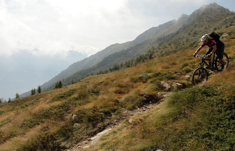 Crossing the Swiss-Italian border and starting the 2000m descent of Col D Anzana